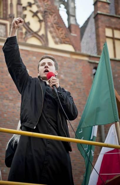 Priest Jacek Międlar at nationalist rally