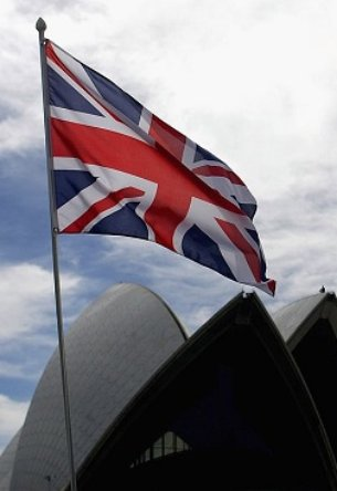 SYDNEY, AUSTRALIA - MARCH 13: The Union flag flies in anticipation of the arrival of Her Majesty Queen Elizabeth II at the Sydney Opera House on March 13, 2006 in Sydney Australia. The Queen and Prince Philip are on a five-day visit to Australia where she will officially open the Commonwealth Games in Melbourne. (Photo by Paul Miller/Getty Images)